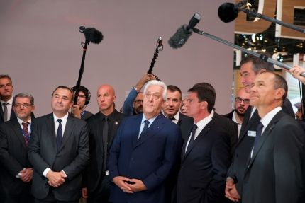 French Prime Minister Manuel Valls visits Plastic Omnium ' booth at the Paris Motor Show